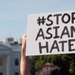 Person holding up sign reading Stop Asian Hate
